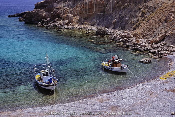 Two small fishing boats moored in a bay, near Hrisoskalitissas monastery Crete, Greece  -  Angelo Gandolfi/ npl