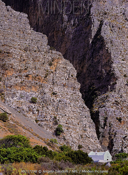 The great crevice of Ha gorge, guarded by a white chapel Island of Crete, Greece  -  Angelo Gandolfi/ npl