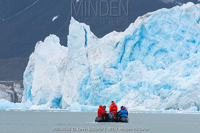 Zodiac boat with travellers in front of the Monaco Glacier, Leifdefjord, Svalbard, Norway 2010  -  Kevin Schafer/ npl