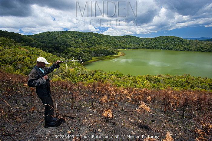 A researcher using a radio receiver to find Madagascar Pochard (Aythya innotata) Bemanevika protected area, north Madagascar, Africa, October 2010  -  Inaki Relanzon/ npl