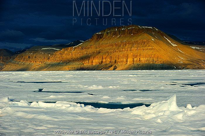 Midnight sun light over icepack and cliffs in spring Arctic Bay, Baffin Island, Nunavut, Canada, April 2009  -  Eric Baccega/ npl