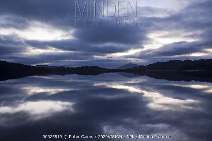 Clouds reflected in Loch Insh at dusk, Cairngorms National Park, Highlands, Scotland, UK, April 2011  -  Peter Cairns/ 2020V/ npl