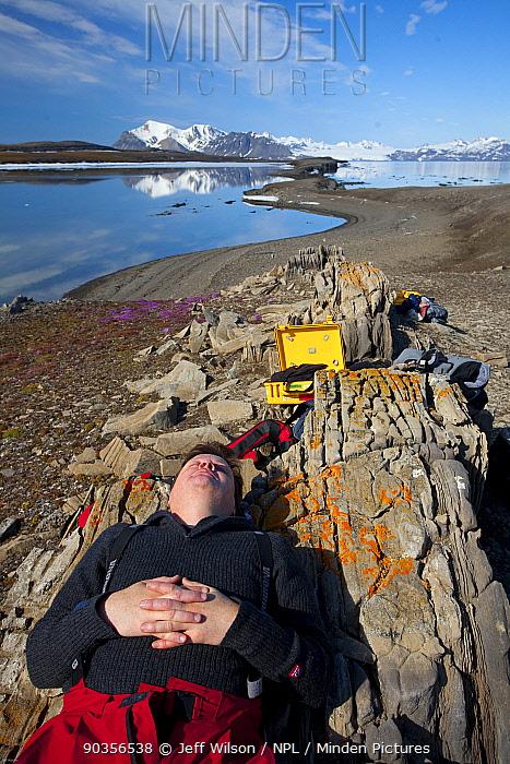 Field Assistant, Jason Roberts, sleeping during filming of Frozen Planet, Svalbard, Spitzbergen, Norway, July 2009, Taken on location for the BBC series, Frozen Planet  -  Jeff Wilson/ npl