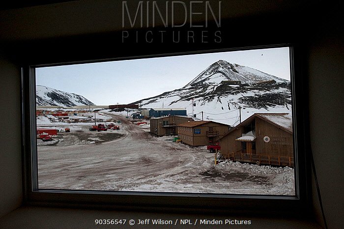 View out of hut window of McMurdo station in early spring light, Ross Island, Antarctica, October 2009 Taken on location for BBC series, Frozen Planet, Winter  -  Jeff Wilson/ npl