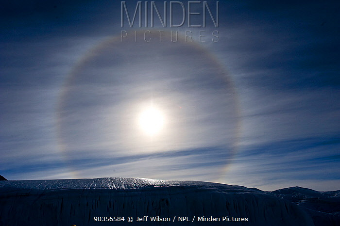 Sun Dog, or Parhelion, caused by refraction of the sun's rays, more commonly seen in Antarctica, above glacier, Dry Valleys, Antarctica, December 2009 Taken on location for the BBC series, Frozen Planet  -  Jeff Wilson/ npl