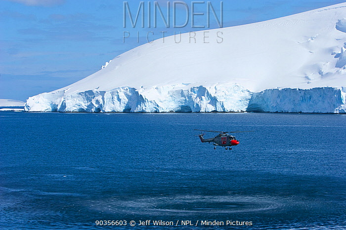 Royal Navy helicopter from HMS Endurance hovering over sea off Antarctica, November 2008, Taken on location for the BBC series, Frozen Planet  -  Jeff Wilson/ npl