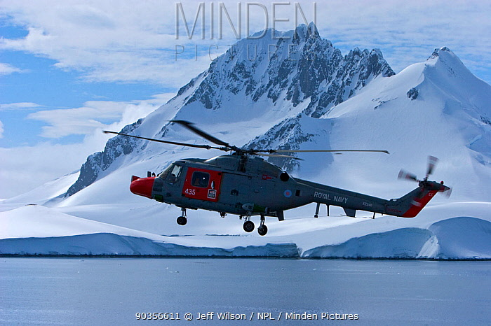 Royal Navy helicopter from HMS Endurance flying over sea and antarctic landscape, November 2008, Taken on location for the BBC series, Frozen Planet  -  Jeff Wilson/ npl