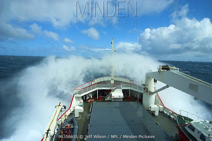 Royal Navy ship, HMS Endurance, crashing through the waves in the south atlantic ocean, Antarctica, November 2009 Taken on location for the BBC series, Frozen Planet  -  Jeff Wilson/ npl