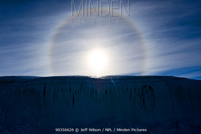 Sun Dog', or Parhelion, caused by refraction of the sun's rays, more commonly seen in Antarctica, above glacier, Dry Valleys, Antarctica, December 2009 Taken on location for the BBC series, Frozen Planet  -  Jeff Wilson/ npl