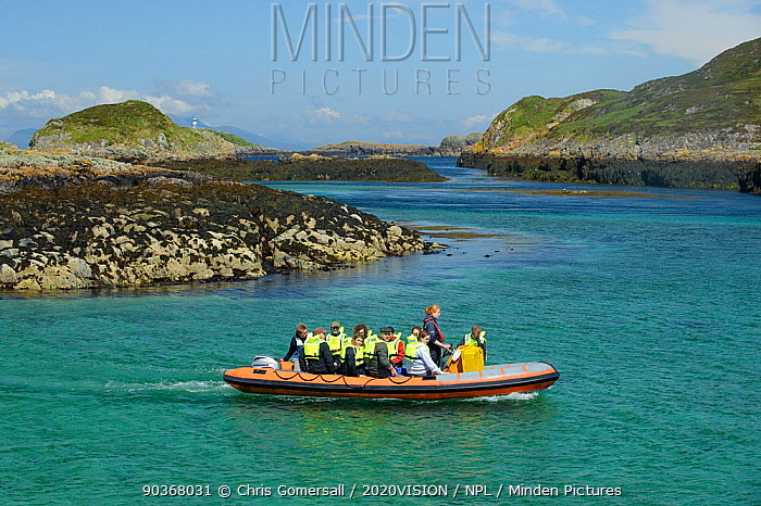 Tourists on board an inflatable boat, Cairns of Coll, Inner Hebrides, Scotland, UK, July 2011  -  Chris Gomersall/ 2020V/ npl