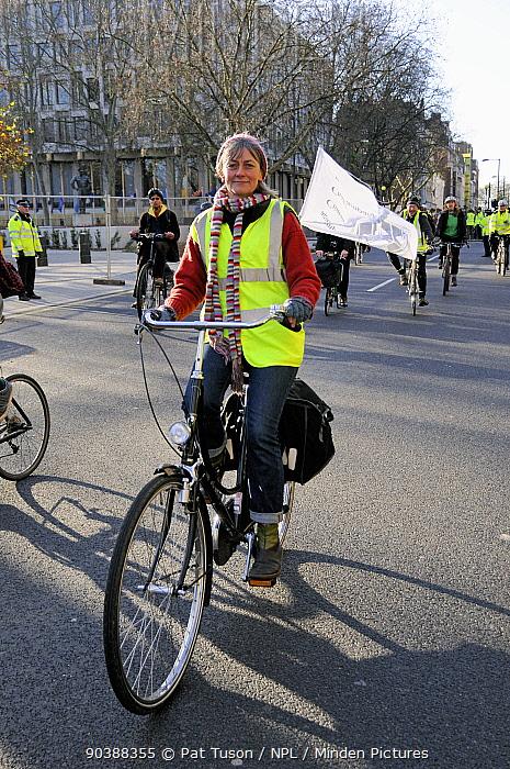 Female cyclist at Climate Change March, London England, UK, December 2008  -  Pat Tuson/ npl