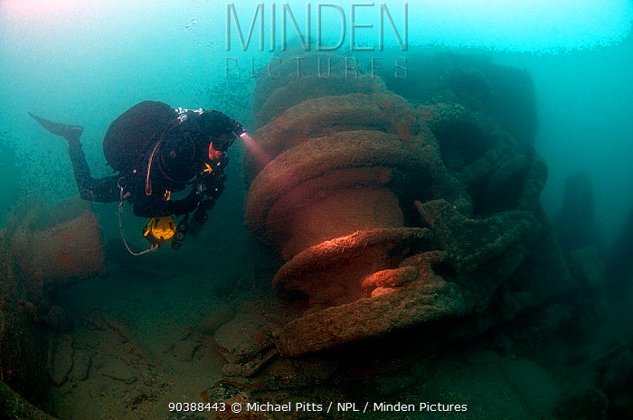 Diver inspecting forward winch on the 'SS War knight' sunk by collision, fire, mine and gunfire during the 1st World War Freshwater Bay Isle of Wight, May 2010  -  Michael Pitts/ npl