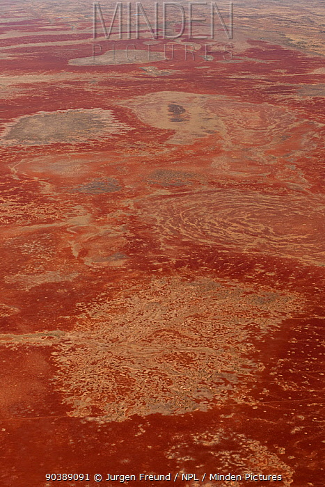 Aerial of Sturt Stoney Desert with gibber rocks Gibber rocks are millions of years wind and water weathered chalcedonised sandstone with a hardened crust of soil cemented silica, iron and manganese, Australia June 2011  -  Jurgen Freund/ npl