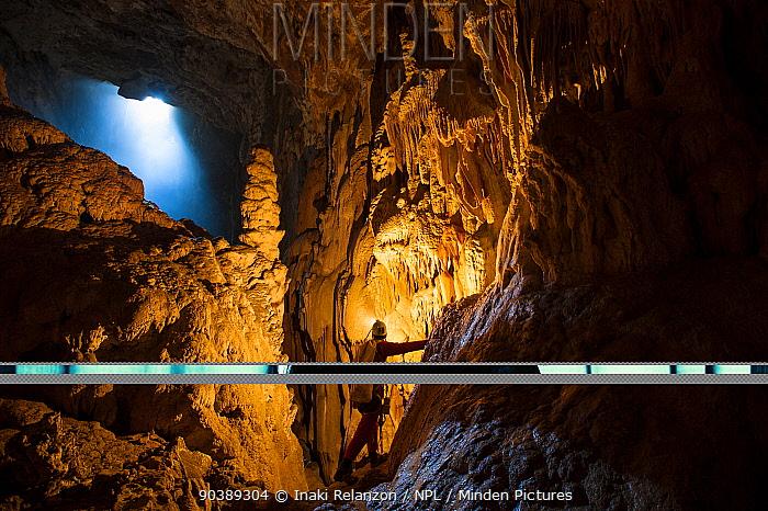 Potholer exploring the Graller del Boixaguer cave, Montsec mountains, Pyrenees, Catalonia, Spain, May 2012  -  Inaki Relanzon/ npl