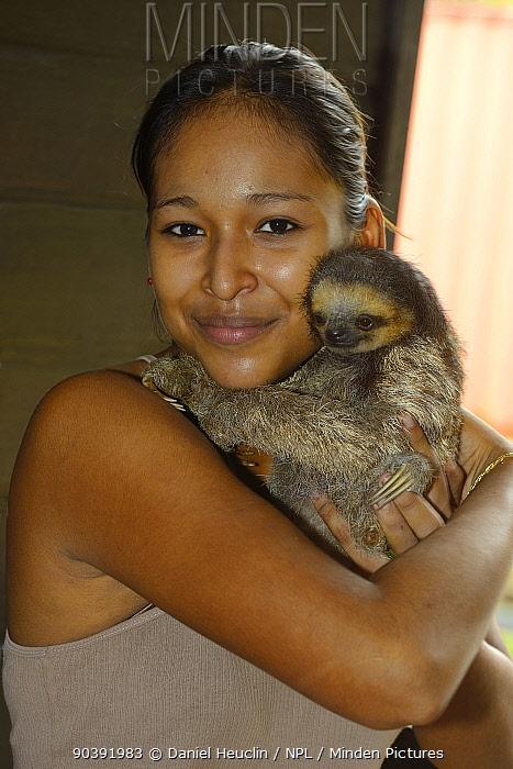 Girl holding young Pale-throated sloth, A? (Bradypus tridactylus) French Guiana  -  Daniel Heuclin/ npl