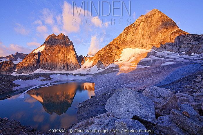 Snowpatch (left) and Bugaboo (right) spires rise above the Crescent glacier at sunrise, Bugaboo Provincial Park, British Columbia, Canada, August  -  Floris Van Breugel/ npl