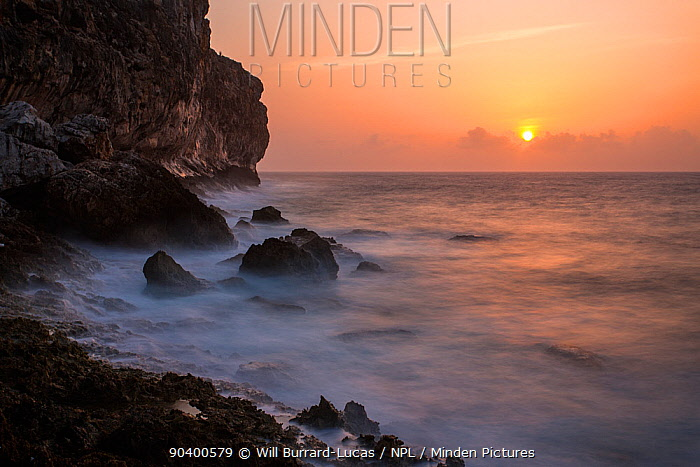 Sun rising over cliffs of Cayman Brac, Cayman Islands  -  Will Burrard-Lucas/ npl