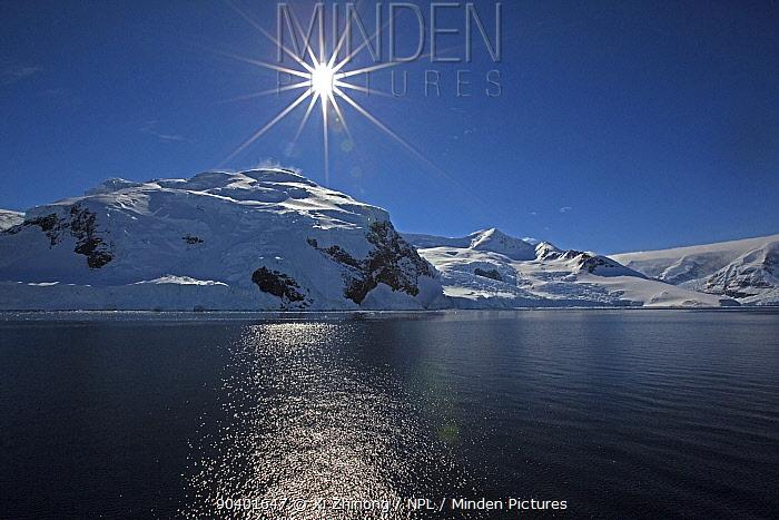 Sun shining over coastal landscape, Antarctica, November 2012  -  Xi Zhinong/ npl