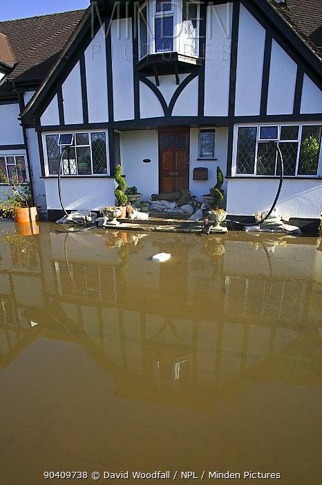 Home flooded during February 2014 floods with sandbags outside Surrey, England, UK, 16th February 2014  -  David Woodfall/ npl
