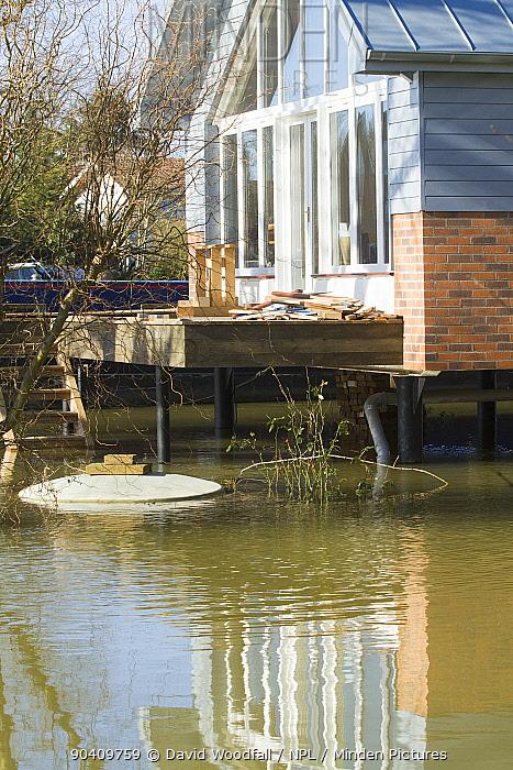 House protected by raised stilts alongside River Thames in February 2014 flood Surrey, England, UK, 16th February 2014  -  David Woodfall/ npl