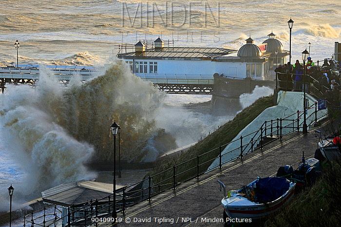 High waves lashing Cromer seafront and pier during storm surge, Norfolk, England, UK December 2013  -  David Tipling/ npl