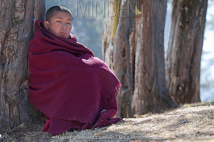 Young monk watching rehearsal of dances in preparation for the Torgya festival Galdan Namge Lhatse Monastery, Tawang, Arunachal Pradesh, India January 2014  -  Bernard Castelein/ npl