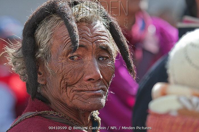 Man in traditional Mompa tribe dress (typical head dress made from Yak hair) during Torgya festival Galdan Namge Lhatse Monastery, Tawang, Arunachal Pradesh, India January 2014  -  Bernard Castelein/ npl
