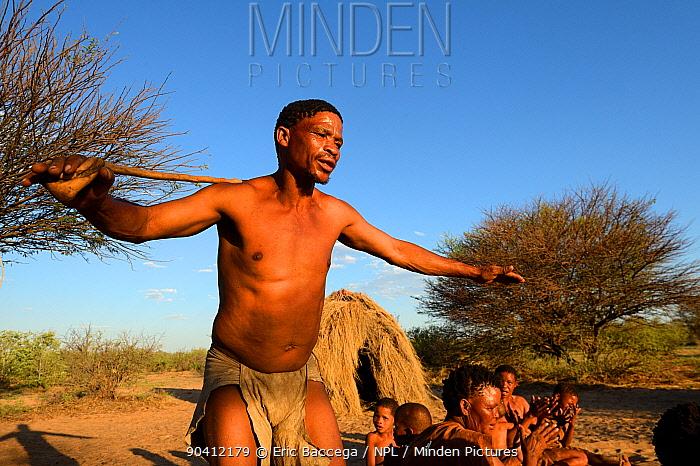 Naro San Bushman with family performing traditional dance, Kalahari, Ghanzi region, Botswana, Africa Dry season, October 2014  -  Eric Baccega/ npl
