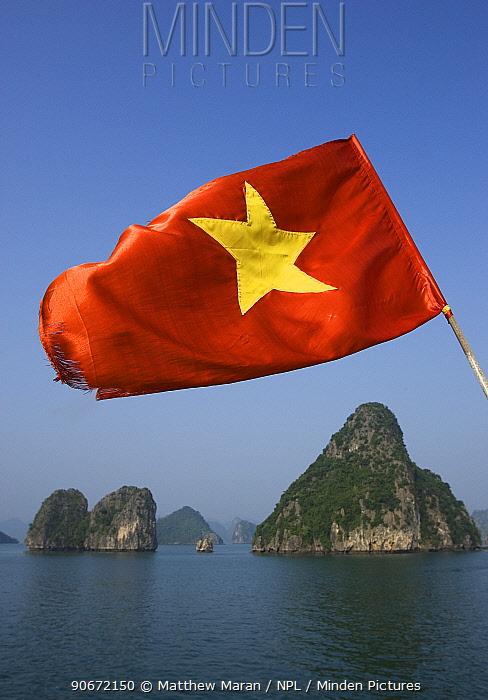 Vietnemes flag flying over Ha Long Bay, Unesco World Heritage Site, Quang Ninh Province, Vietnam  -  Matthew Maran/ npl