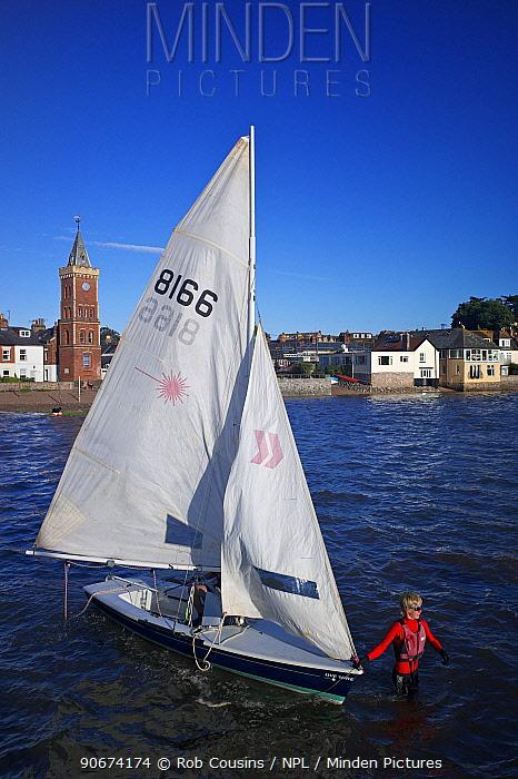 Man launching sailing dinghy at Lympstone harbour, Exe Estuary, Devon, UK, July 2013  -  Rob Cousins/ npl