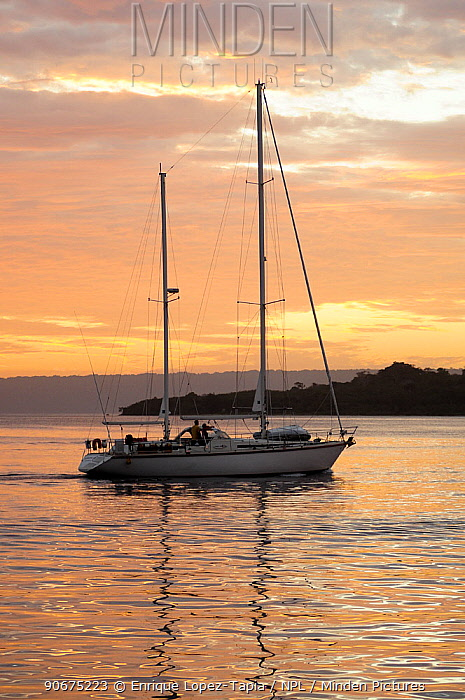 Sail boat at sunset Port Vila Bay, Efate Island, Vanuatu, September 2008  -  Enrique Lopez Tapia/ npl