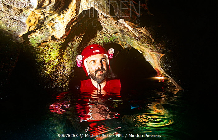 BBC Producer Neil Nightingale in a limestone tunnel, Rock Islands, Palau Model released  -  Michael Pitts/ npl
