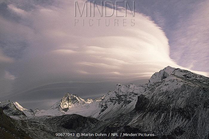 Lenticular clouds forming over the Italian Alps  -  Martin Dohrn/ npl