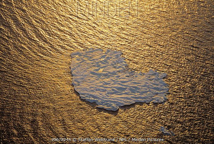 Aerial view of ice floe in midnight summer sun, floating off Ellesmere Island, Beaufort Sea, Arctic, Canada  -  Staffan Widstrand/ npl