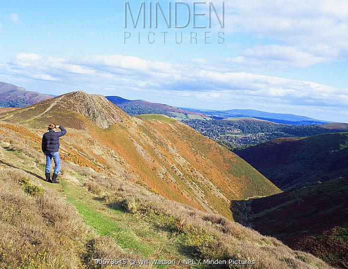 Hiker admiring the view of Devil's Mouth, Long Mynd SSSI, Shropshire Hills AONB, UK  -  Will Watson/ npl