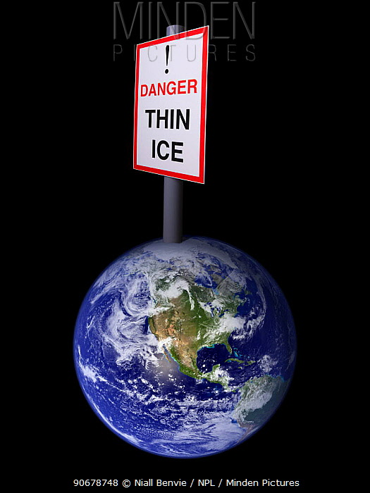 A conceptual picture of Global warming illustrated through a model of the earth with a sign at the North Pole saying Danger, Thin Ice  -  Niall Benvie/ npl