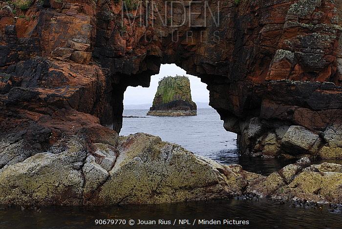 View of coast through rock arch, Papa Stour island, Shetland Islands, Scotland, UK  -  Jouan & Rius/ npl