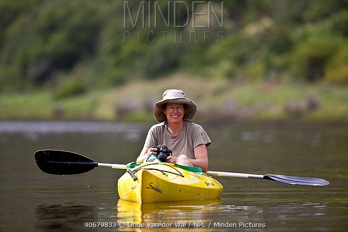 Woman in kayak with camera, South Africa December 2008  -  Onne Van Der Wal/ npl