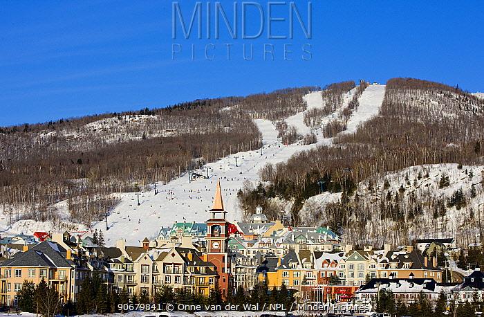 Colourful village of Mount Tremblant with busy ski slopes beyond Quebec, Canada, 2008  -  Onne Van Der Wal/ npl