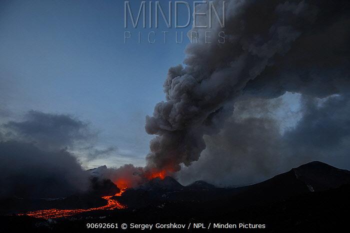 Dark ash plume and stream of red hot lava from Plosky Tolbachik Volcano eruption, Kamchatka Peninsula, Russia, 15 December 2012  -  Sergey Gorshkov/ npl