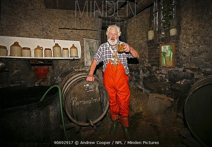 Cider maker Ron Barter testing his product Devon, UK, November 2011  -  Andrew Cooper/ npl