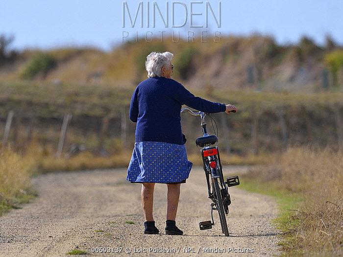 Woman pushing her bike Breton marshes, west France, September 2012  -  Loic Poidevin/ NPL