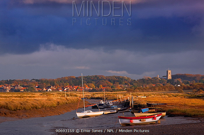View towards Blakeney village with boats and stormy clouds, Morston Quay, Norfolk, November 2012  -  Ernie Janes/ npl