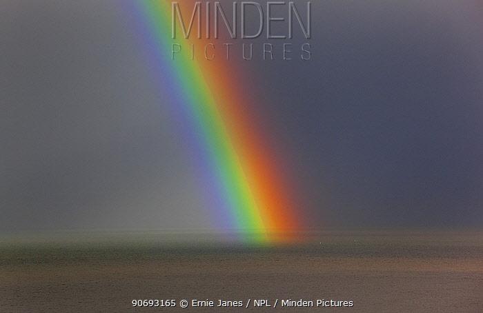 Rainbow, during rain storm, Weybourne, Norfolk, UK, November  -  Ernie Janes/ npl
