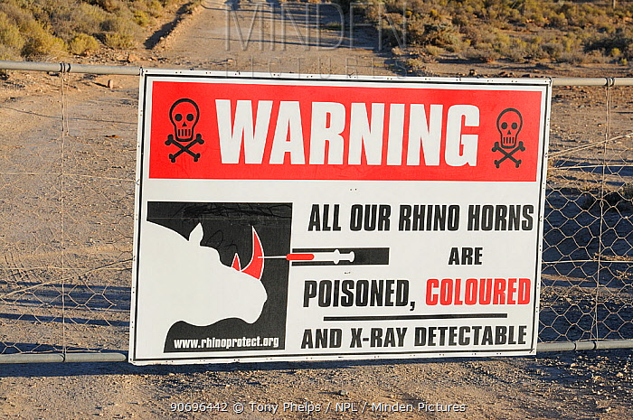 Warning sign explaining that rhino horns within reserve are poisoned and coloured Private game reserve, near Ceres, Karoo, South Africa, November  -  Tony Phelps/ npl