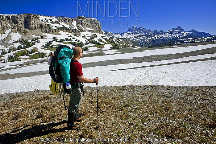 Man hiking along the Teton Crest Trail between Marion Lake and Fox Creek Pass, Grand Teton Natoinal Park Wyoming, USA, July 2011 Model released  -  Kirkendall-spring/ npl