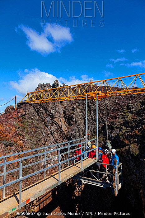 Tourists being lowered into Thrihnukagigur volcano, a dormant volcano now used for tours, by cable lift Iceland, Europe, June 2012  -  Juan Carlos Munoz/ npl