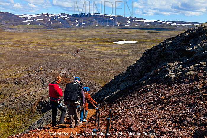 Tourists walking away from the Thrihnukagigur volcano, a dormant volcano now used for tours inside Iceland, Europe, June 2012  -  Juan Carlos Munoz/ npl