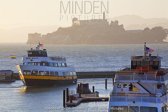 Alcatraz Island, seen behind ferries at dusk, San Francisco, California, USA, June 2011  -  Gavin Hellier/ npl
