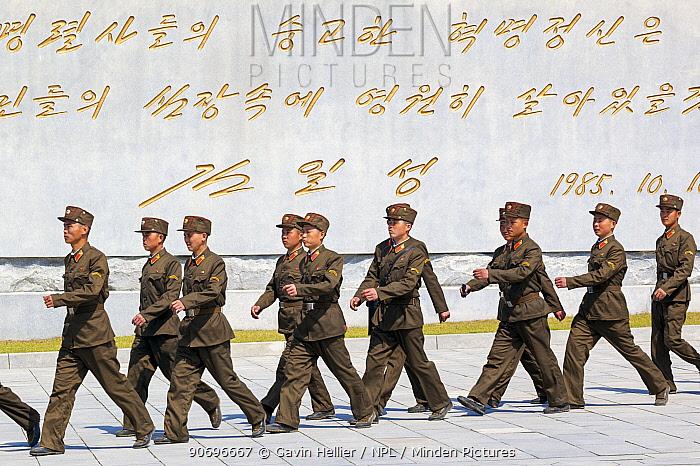 Uniformed men marching at Revolutionary Martyrs' Cemetary, Democratic Peoples' Republic of Korea (DPRK), North Korea, April 2012  -  Gavin Hellier/ npl